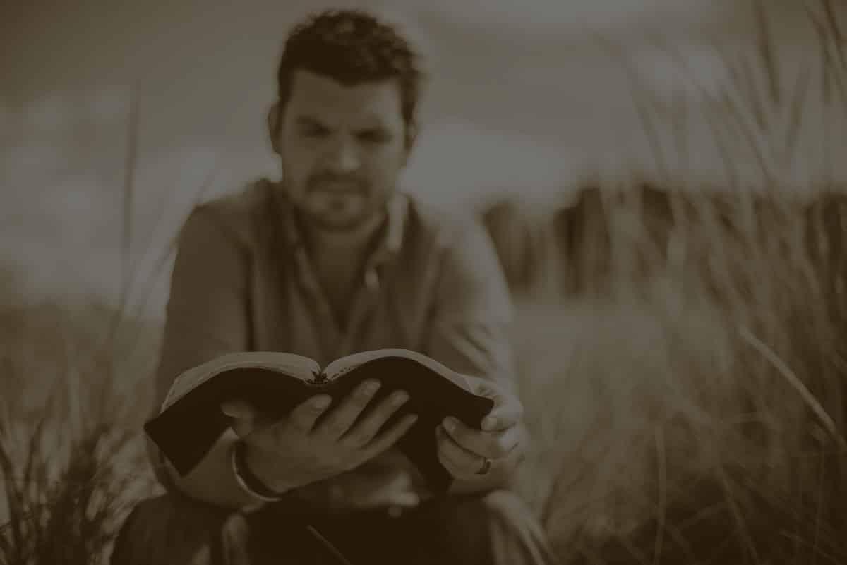 man-reading-roadmap-on-the-field